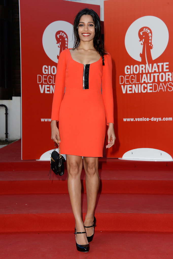 Freida Pinto wore a fitted red dress for a Miu Miu event during the Venice Film Festival.