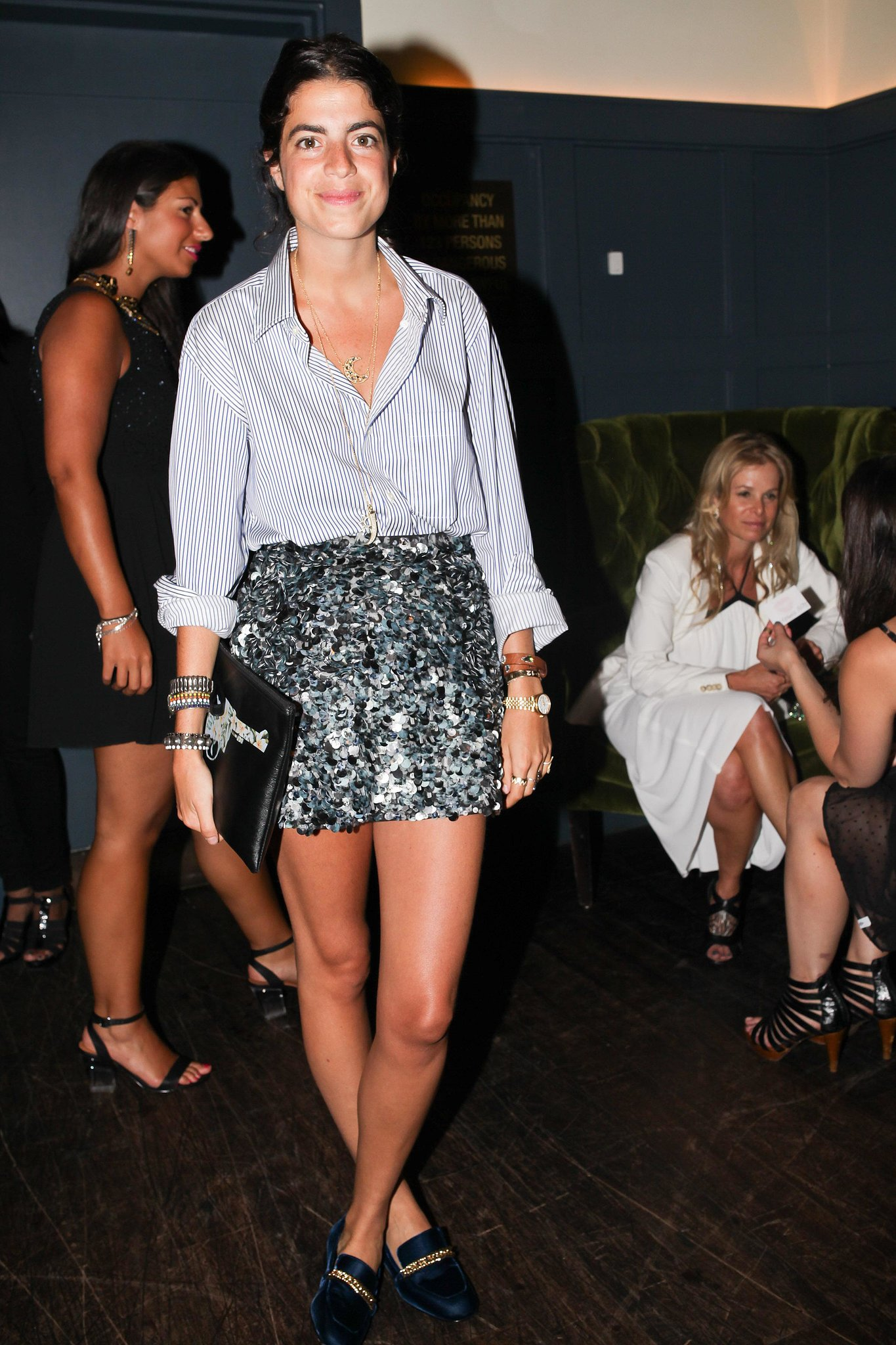 Leandra Medine added a little glamour to her button-down with paillette shorts while previewing Erickson Beamon's latest collection.