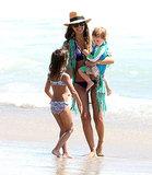 Clad in a bikini, Jessica Alba carried little Haven on the beach.