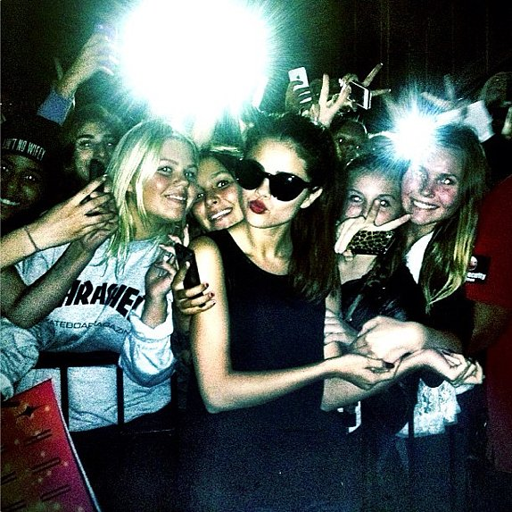 Selena Gomez got snap happy in cat-eye shades while posing with fans.  Source: Instagram user selenagomez