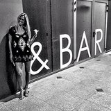 Bar Refaeli posed next to her name outside a restaurant. Source: Instagram user barrefaeli
