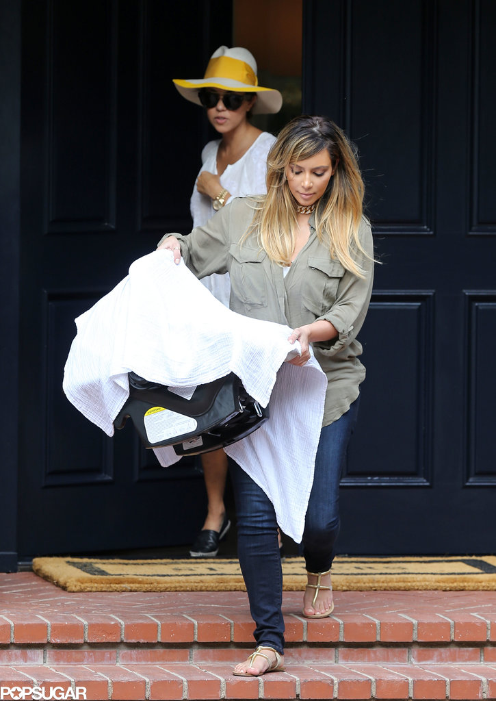 Kim Kardashian carried North West while leaving with Kourtney Kardashian.
