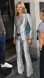 Kate Moss arrived at Christie's in London wearing a silver suit.