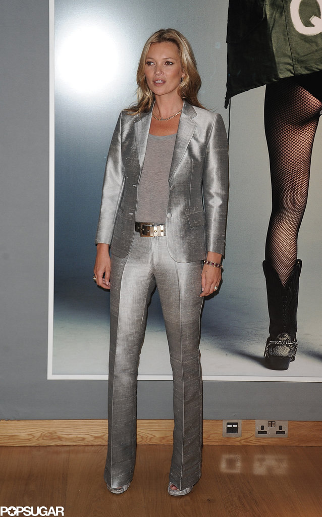 Only Kate Moss Can Rock a Silver Suit in Front of Her Own Topless Photo