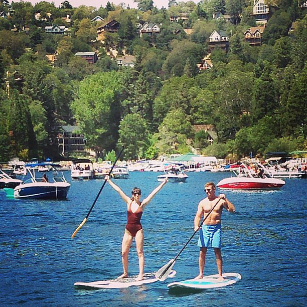 Talk about balance! That's Whitney Cummings getting in some stand-up paddleboard action with director Michael Patrick King. Source: Instagram user whitneyacummings