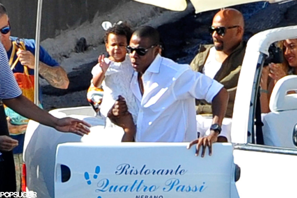 Jay Z held on to his daughter, Blue Carter.