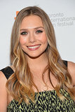 Elizabeth Olsen showed off polished waves on the Therese premiere red carpet in Toronto.