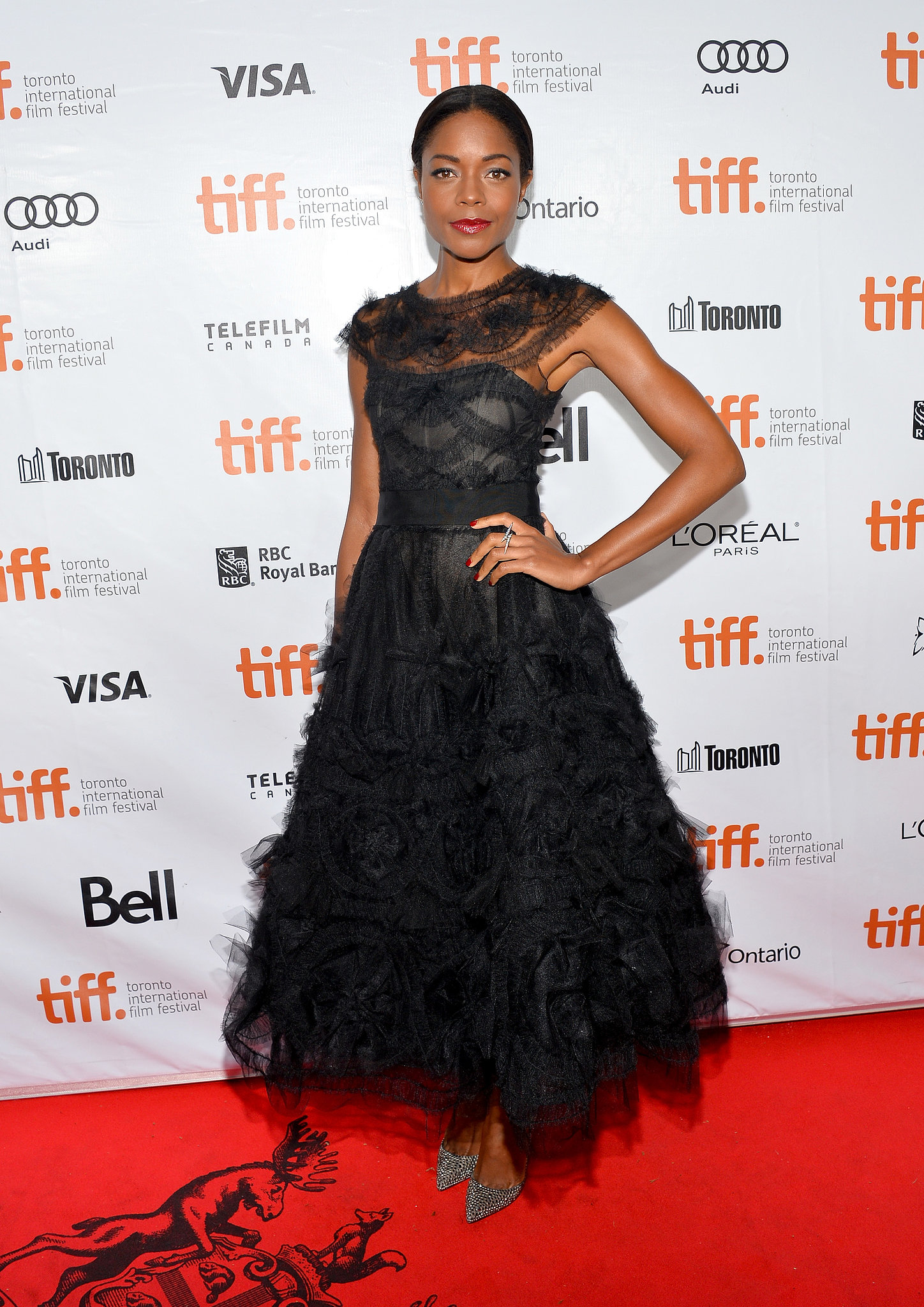 Naomie Harris wore a stunning feathered frock at the premiere of Mandela: Long Walk to Freedom.