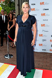 Kate Winslet put her baby bump on display in a navy Jenny Packham gown and Rupert Sanderson heels at the Labor Day premiere in Toronto.