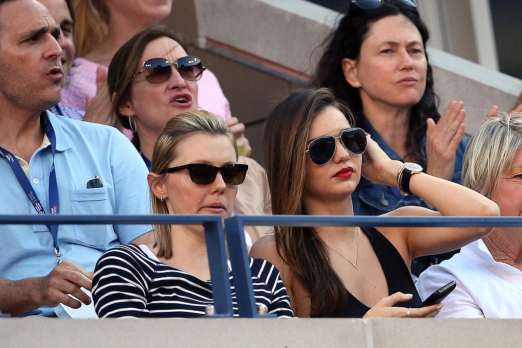 Miranda Kerr looked cool in aviator sunglasses and a black tank while watching the US Open.