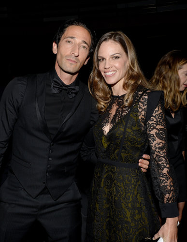 Hilary Swank and Adrien Brody got together at the amfAR gala in Toronto.