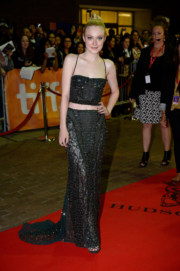 Dakota Fanning showed off her midriff on the red carpet at the Night Moves premiere.
