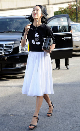 Eva Chen perfected ladylike cool with a full skirt and Mickey Mouse sweater.