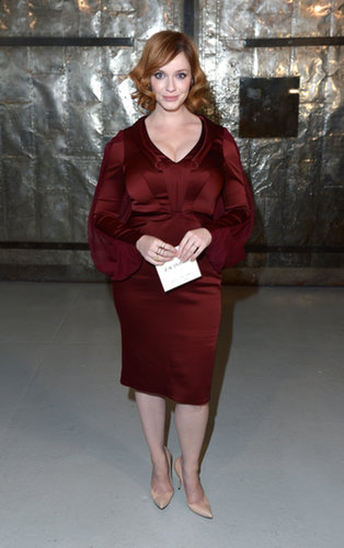 Christina Hendricks matched a deep-red silky dress with nude pumps at Zac Posen.