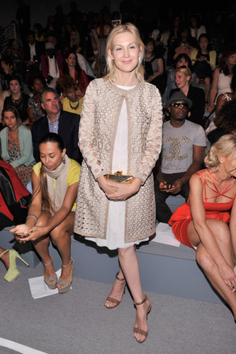 Kelly Rutherford was prim and proper in a neutral ensemble, including a cool cutout coat, at Vivienne Tam.