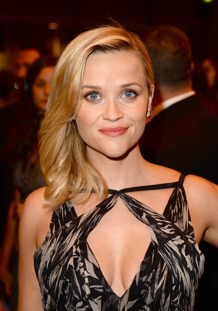 At the premiere of The Devil's Knot, Reese Witherspoon had a glamorously sideswept style that complemented her dewy skin and flushed lips.