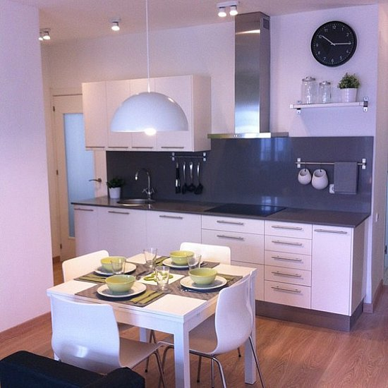 Sleek white cabinetry is balanced with a glossy grey backsplash for a futuristic feel.  Source: Instagram user iloftyou