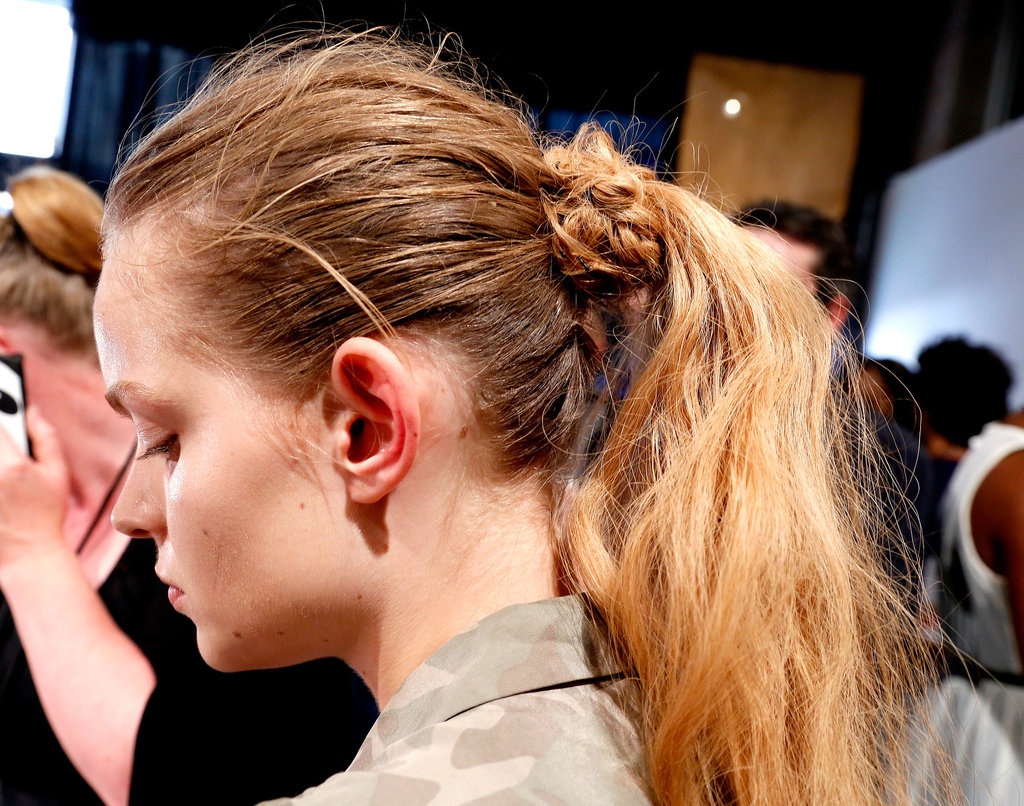 A bun before the ponytail at Christian Siriano.
