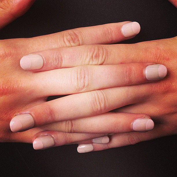 This is one of many half-moon manicures from the catwalk this season, but we love how it was inverted at Alice + Olivia.