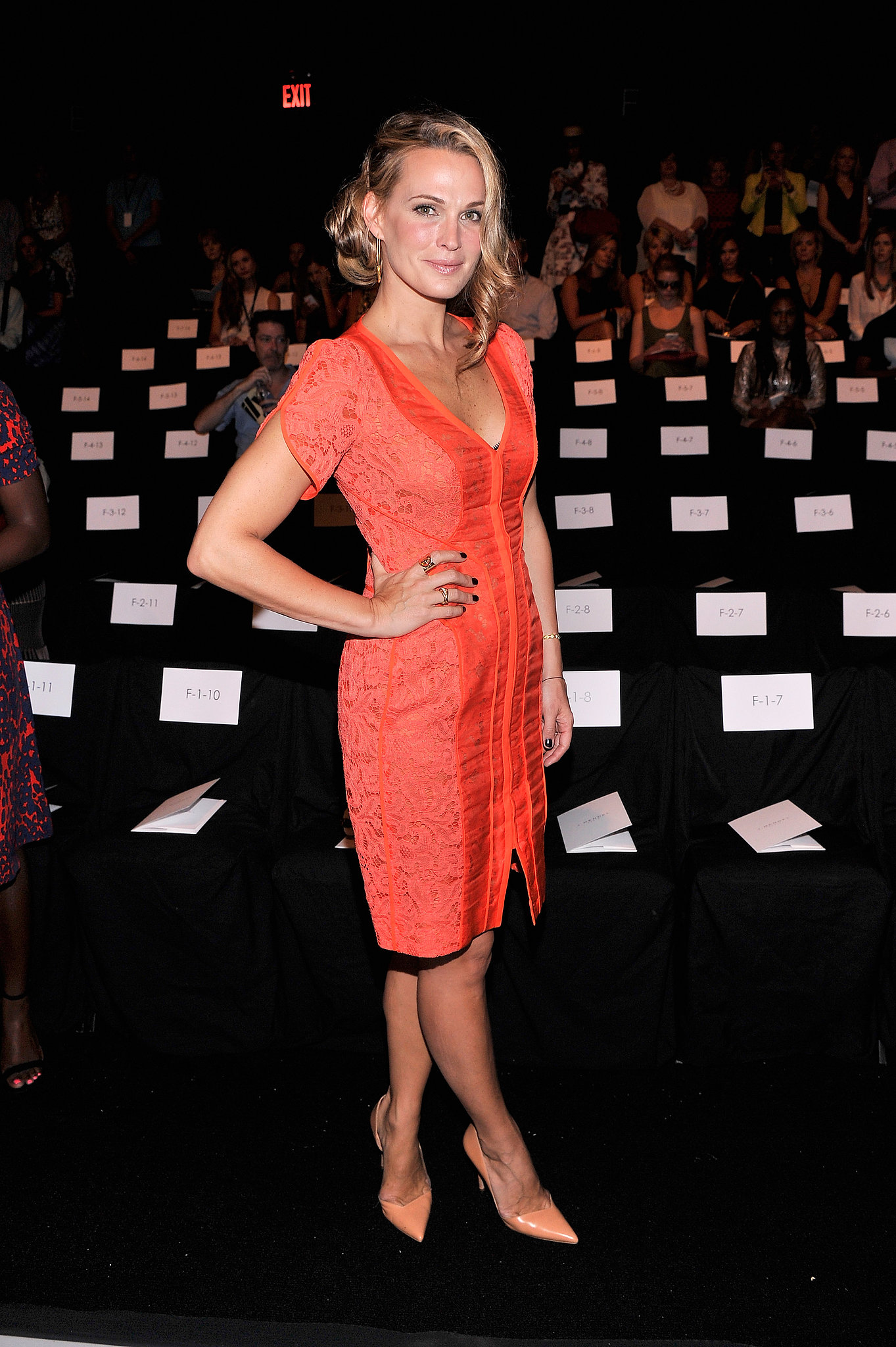 Molly Sims matched an orange J. Mendel dress with coral pumps at the designer's Spring 2014 show.