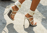 Bright white Gucci heels.