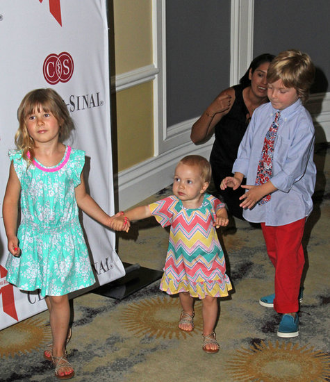 Liam McDermott played baby wrangler and big brother when taking Stella and Hattie to an event.