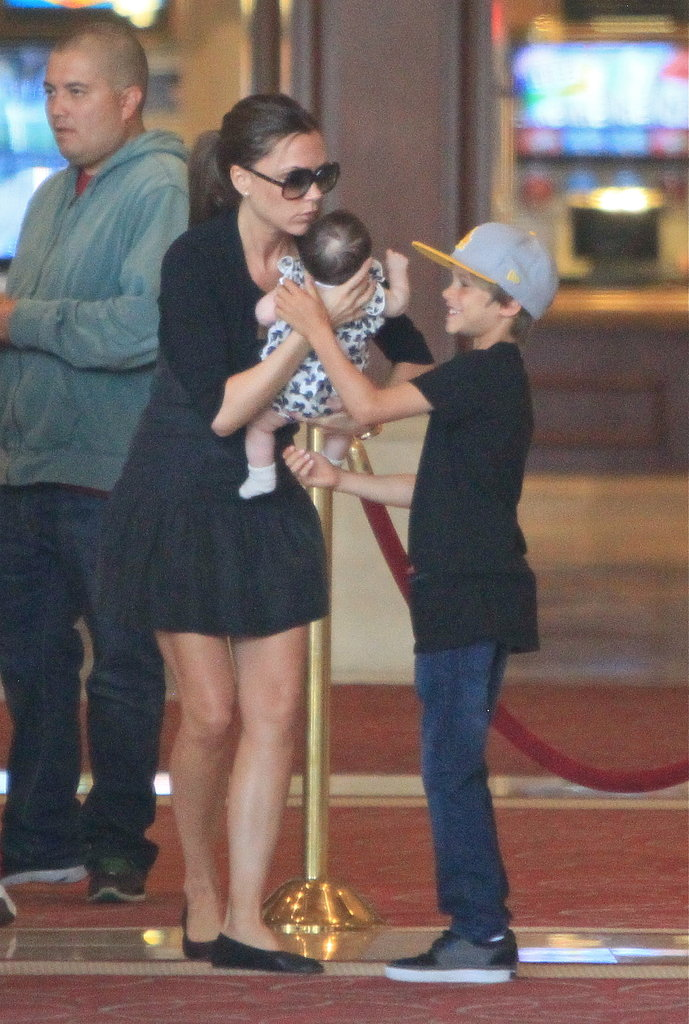 Romeo Beckham couldn't wait to get his hands on baby Harper and help his mama, Victoria Beckham, out.