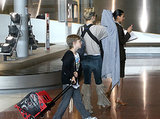 When Kate Hudson's hands (and arms) were full with baby Bing, Ryder Robinson lent a helping hand with the luggage.