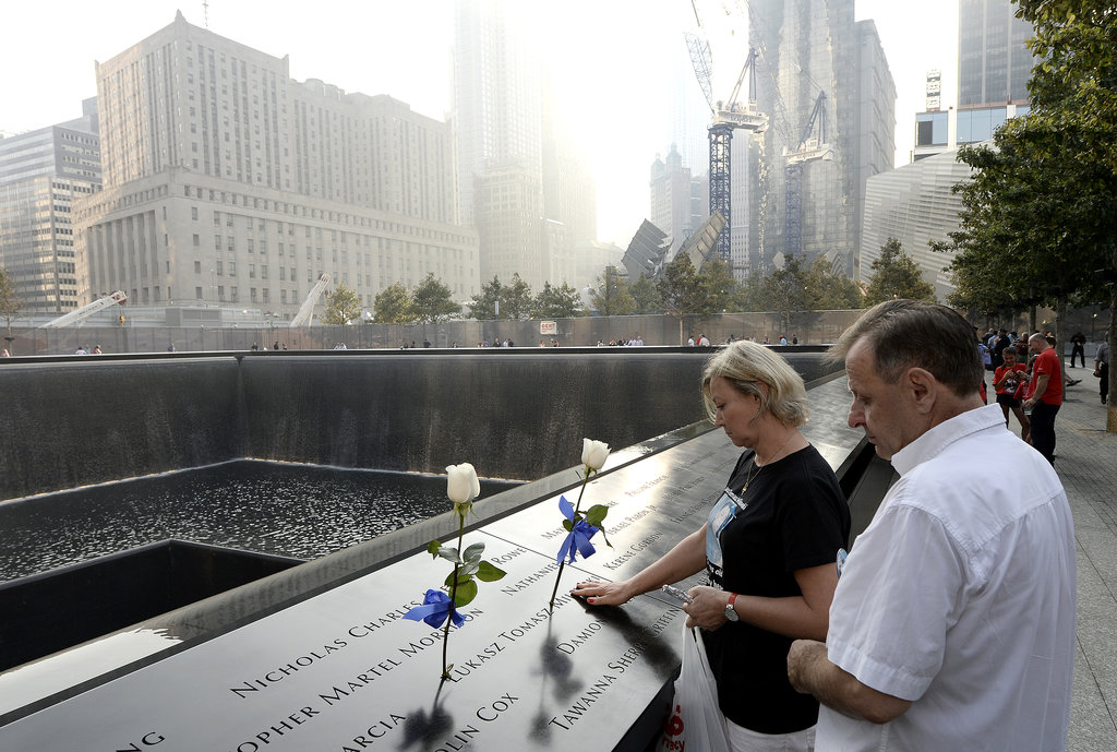 A couple paused beside the 9/11 Memorial during the ceremonies in NYC.