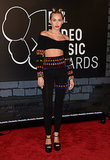 Miley Cyrus bared her midriff on the red carpet at the MTV VMAs on Aug. 25.