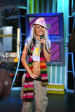 Christina Aguilera sported a fedora with a striped scarf on TRL in 2002.