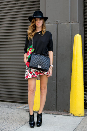 Chiara Ferragni was one part girlie-girl, one part boho in a wide-brim hat and florals.