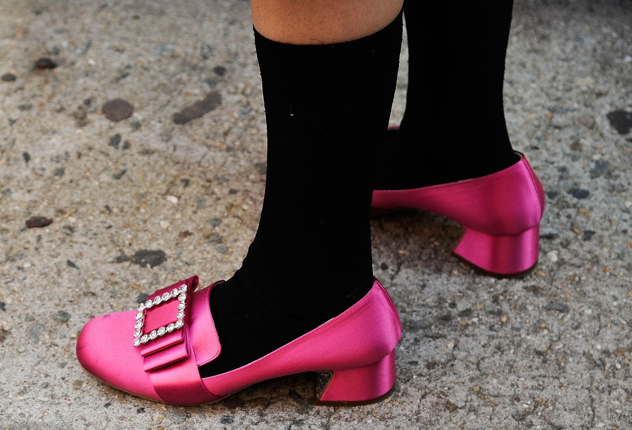 A stark contrast between her bright loafers and socks.