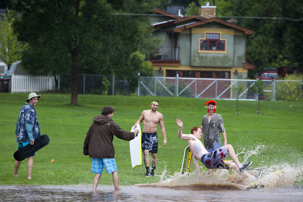 People splashed around in the flooded streets of Boulder, CO.