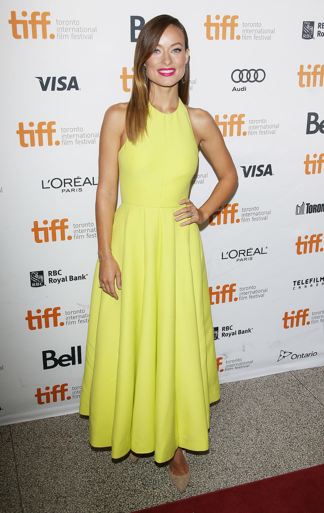 How can you not look twice at Olivia Wilde in a bright yellow halter dress and hot pink lipstick at the Third Person premiere in Toronto?