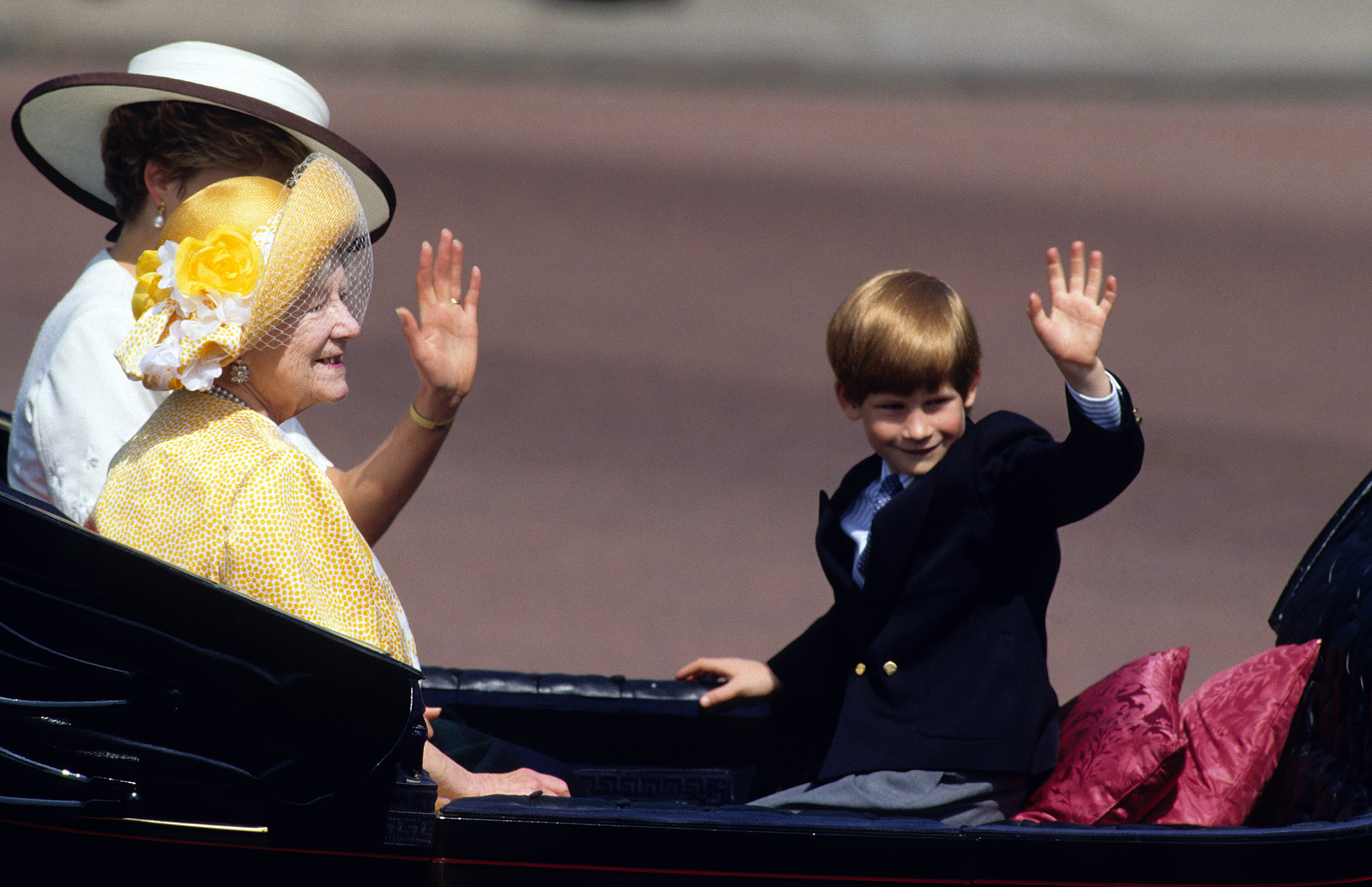 Prince Harry waved from an open carriage with Queen Elizabeth at the Trooping the Colour ceremony in June 1992.