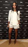 Zoe Saldana wore all white to the Longchamp store opening celebration in London.