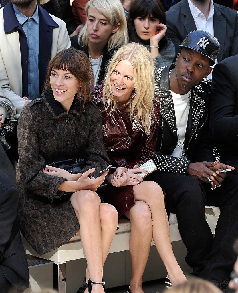 Alexa Chung and Poppy Delevingne watched the Burberry Prorsum show together during London Fashion Week.