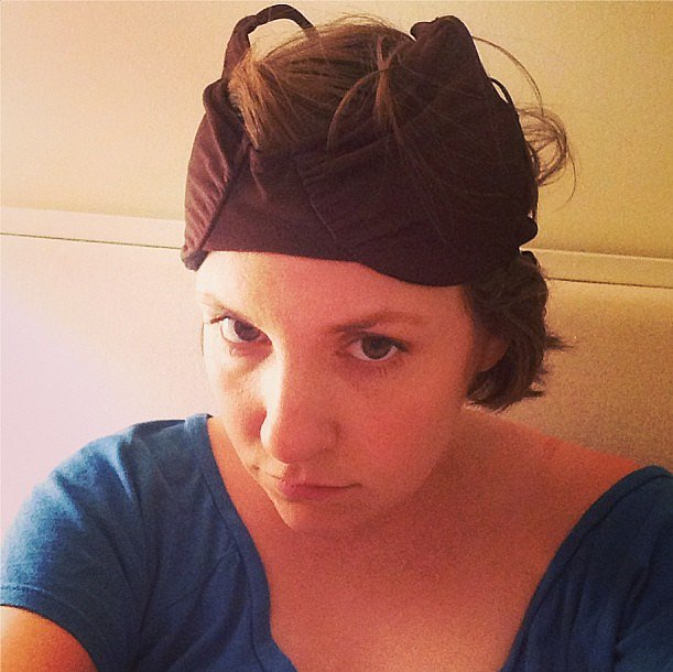 In a thought-provoking snap, Lena Dunham wondered if her makeshift hat (aka bra) could be confused for the work of a milliner's. Source: Instagram user lenadunham