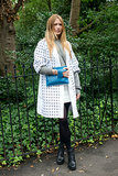 Her printed cardigan and blue zippered clutch added a little quirk to a sweatshirt and tights.