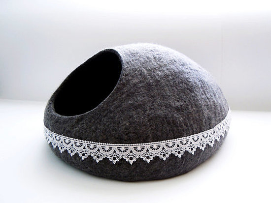 The lace detailing on this grey felted cat bed (from $64) takes it to the next level.