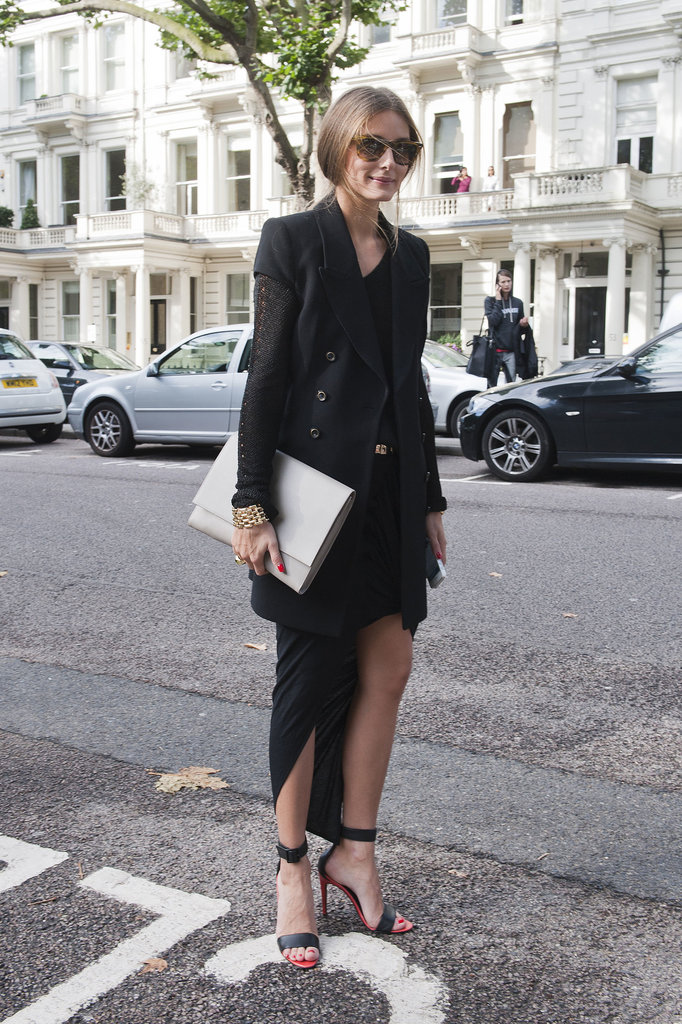 Olivia Palermo amped up an all-black look with  a sleeveless blazer, ankle-strap Tibi heels, and an oversize clutch.