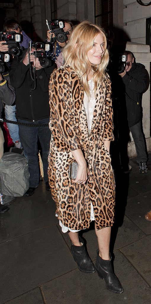 Sienna Miller broke out the leopard print and black booties for the British Vogue party.