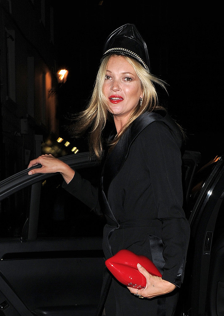 Kate Moss wore a cap for a costume party in London.