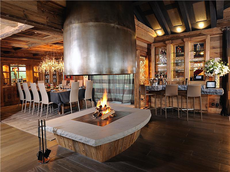 Giving a new twist to cabin living, this dining room blends rustic finishes with industrial lines in a way that is completely unique.  Source: Sotheby's Realty