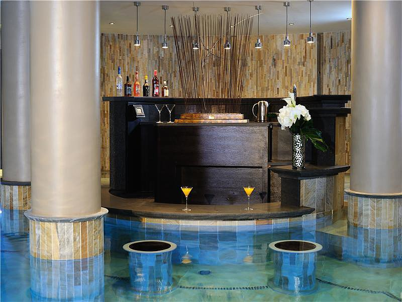 After a long day of skiing, unwind with a cocktail or two at the swim-up bar — no tip needed.  Source: Sotheby's Realty
