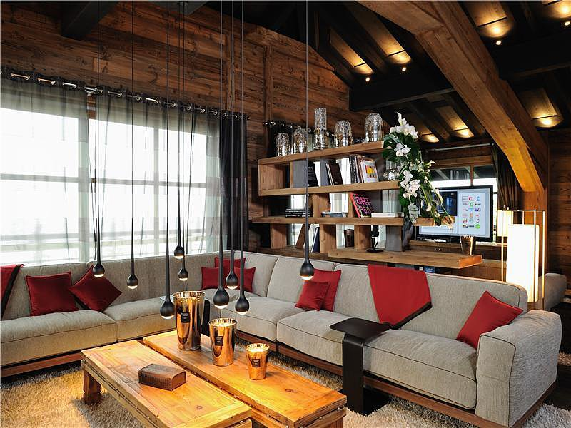 A truly luxurious chalet, this media room is nothing short of streamlined woodwork and modern decor.  Source: Sotheby's Realty