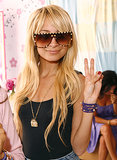 Nicole Richie flashed a peace sign at a Disney Couture party hosted by her longtime friend Kidada Jones in May 2007.