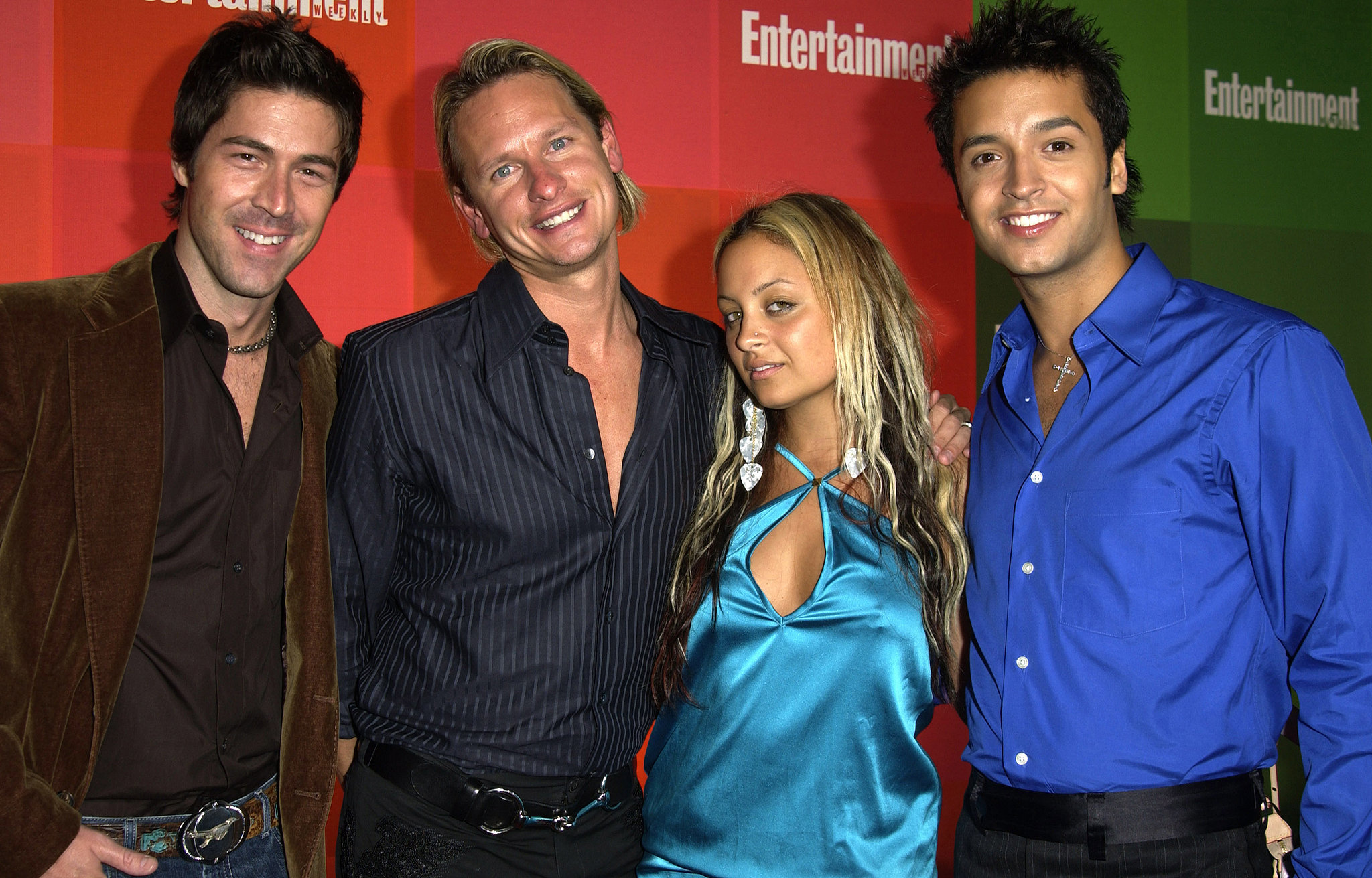 Nicole Richie hit up a pre-Emmys party in September 2003 and posed for photos with some cast members from Queer Eye For the Straight Guy (remember that show?).