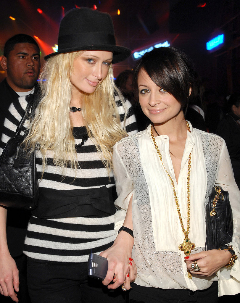 A dark-haired Nicole Richie stuck close to her pal Paris Hilton during an LA soirée in November 2006.